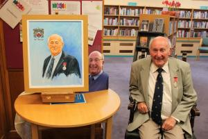 Malcolm with his painting (by local artist Steve McGrath)